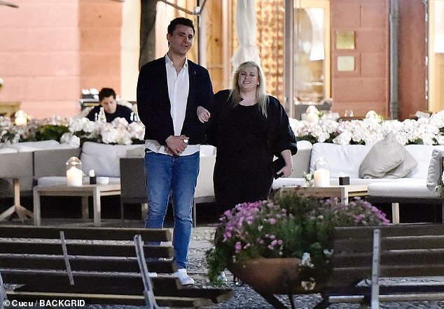 Rebel Wilson links arms with unlikely pal and former Pop Idol star Darius Campbell in Portofino