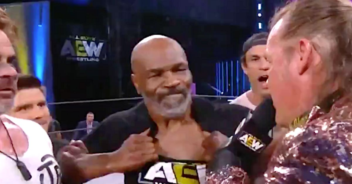 Mike Tyson Tries To Tear Off His Shirt And It Doesn't Go Well