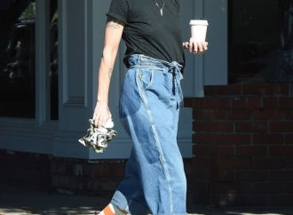 Lena Headey wears baggy jeans and striped socks to get coffee in LA